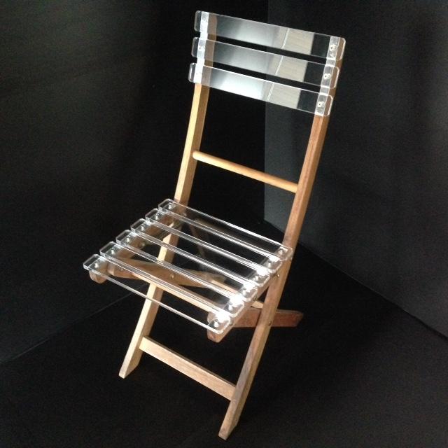 Chaise de jardin pliable bois plexi marcorelles for Chaise plexi bois